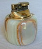 A 1970s onyx cigarette lighter was used as prop in Abigail's party