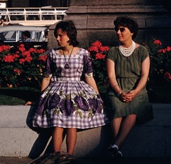 Brightly pattened dresses with wide skirts were popular in the late 50s