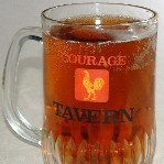 A pint of Courage Tavern