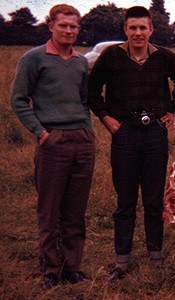 Two young men wearing casual clothes in the late 50s, jeans or casual trousers, casual shirts, and pullovers